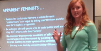 "Erin Frost giving a talk in front of a slide titled ""apparent feminism"""