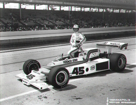 Janet Guthrie poses with her car