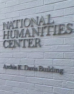 photo of the words National Humanities Center on white-pained bricks